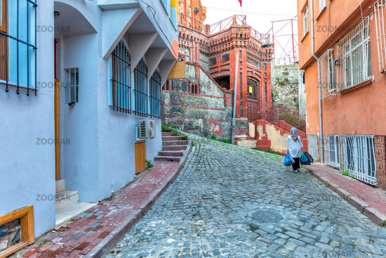 Old narrow street of Fener and a Turkish lady, Istanbul