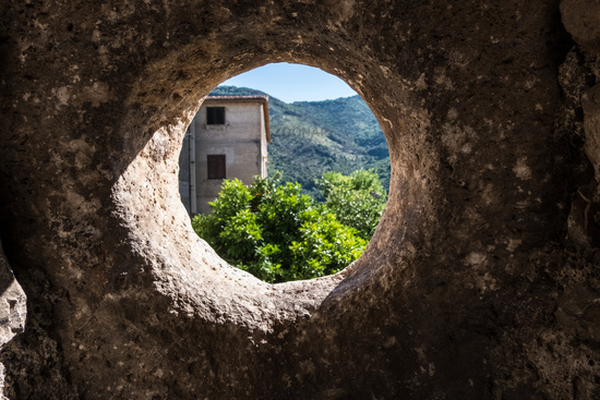 Sun entering from a window of a medieval wall.