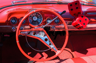 Red car interior with red dice