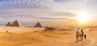 Famous Giza Pyramids in the desert, beautiful scenery with bedouins and camels, Cairo, Egypt