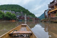 Fenghuang, China - May 30, 2018: Boat trip in the ancient town Fenghuang in Hunan