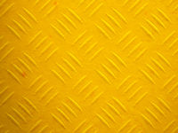a yellow painted diamond metal plate texture