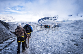 Group of mountaineers on snowy mountain in Iceland