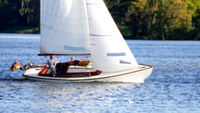 Blurred people sailing in a sailing boat