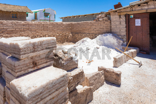 Bolivia Colchani blocks of salt and pickaxes