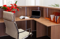 workplace with laptop in office