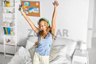happy woman in headphones having fun at home