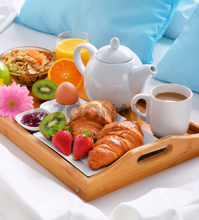 Breakfast tray in bed in hotel room