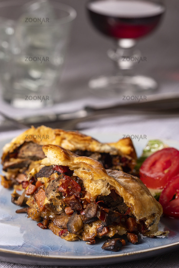 Steak in puff pastry on a plate