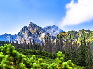 Polish Tatra mountains summer landscape with blue sky and white clouds.
