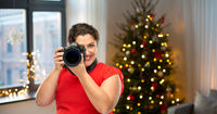 happy woman photographer with digital camera