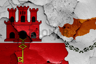 flags of Gibraltar and Cyprus painted on cracked wall