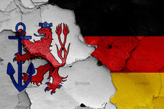 flags of Dusseldorf and Germany painted on cracked wall