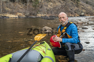 environmental portrait of a senior kayaker