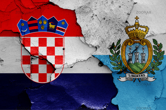 flags of Croatia and San Marino painted on cracked wall