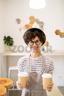 Cheerful barista offering to drink coffee