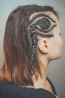 pigtails on the temple, a spiral of hair, a hairstyle of curly braids patterns fashion hairstyle