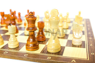 Chess pieces stand on chessboard