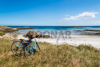 Bicycle parked against the sea in the island of Batz