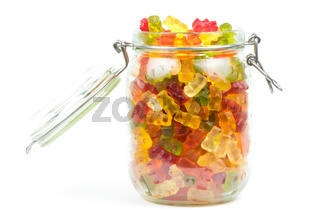 Mixed gummy bears / jelly baby candy sweets in an open jar on a white background