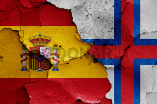 flags of Spain and Faroe Islands painted on cracked wall