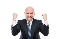 Smiling businessman winner gesturing raised hands fist celebrating victory achievement