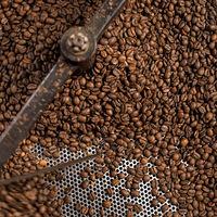 Mixing machine of coffee bean roaster at work