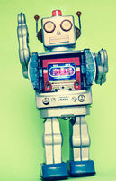 waving retro robot with a green background