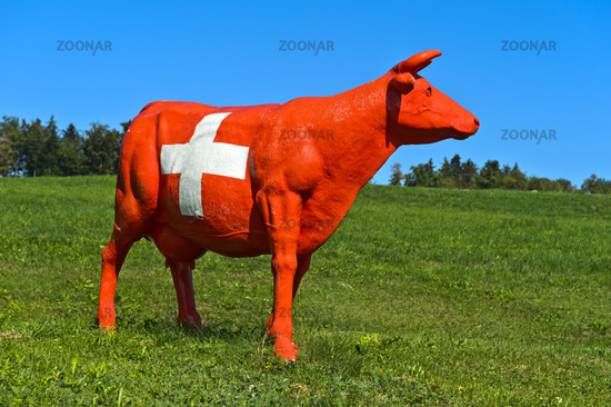 CowParade cow painted in the style of the Swiss national flag with the Swiss cross, Switzerland