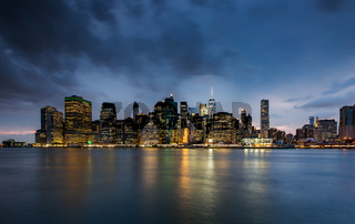 Cloudy day at Lower Manhattan Skyline view from Brooklyn Bridge Park, New York United States