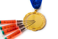 Gold medal and syringes