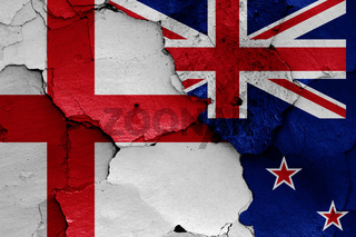 flags of England and New Zealand painted on cracked wall