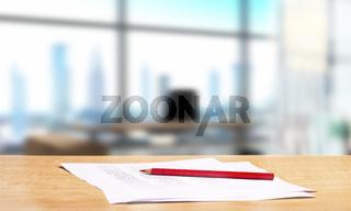 Büro mit Schreibtisch und Rotstift