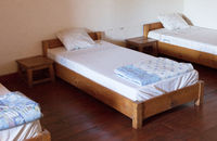 Old wooden bed (dormitory)