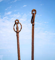 old rusted metallic objects with a ring
