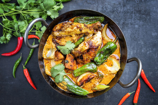 Traditional Thai kaeng massaman coconut chicken curry with jalapeno