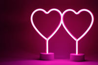 Two neon hearts