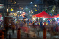 Long exposure motion night time image of a Loas night market.