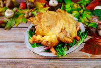 Roasted turkey with corn and lettuce on plate.