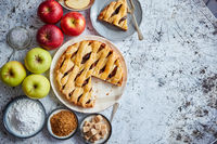 Delicious apple pie cake with a fresh fruits, brown and powder sugar