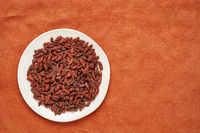 dried goji berries on a white plate