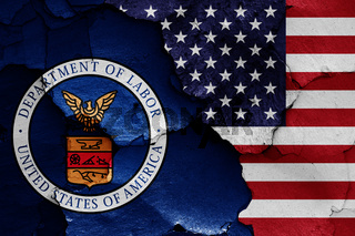 flags of Department of Labor and USA painted on cracked wall