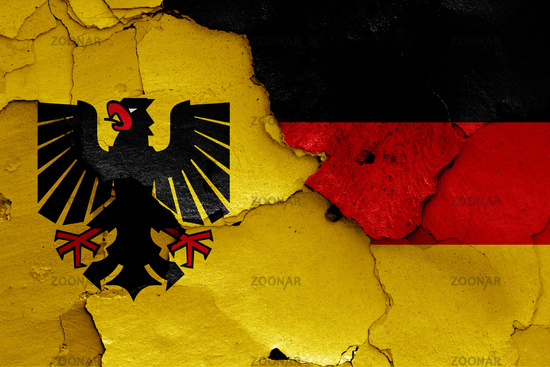 flags of Dortmund and Germany painted on cracked wall