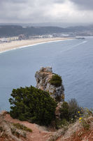 Nazare, Portugal - July 19, 2019 : The bay of Nazre shrouded in the mist, as seen from the Miradouro