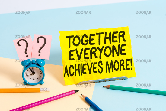 Text sign showing Together Everyone Achieves More. Conceptual photo Members create synergy with strong sense mutual commitment Mini size alarm clock beside stationary placed tilted on pastel backdrop.