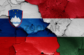 flags of Slovenia and Hungary painted on cracked wall