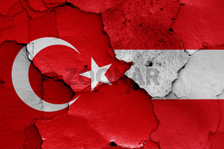 flags of Turkey and Austria painted on cracked wall