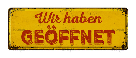 German words  Wir haben geöffnet ( We are open) on a vintage rusty metal sign