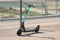 Electric scooter , escooter or e-scooter of the ride sharing company TIER on sidewalk in Berlin