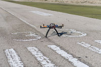 Professional drone ready to fly in the airfield